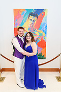 Zach Smith and Aziza Al-Daraji pose with an Ali painting as Fairdale High School holds it's prom at the Muhammad Ali Center on Saturday, May 18.