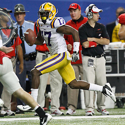 Dec 3, 2011; Atlanta, GA, USA; LSU Tigers cornerback Morris Claiborne (17) runs back an interception for a touchdown during the second half of the 2011 SEC championship game against the Georgia Bulldogs at the Georgia Dome.  Mandatory Credit: Derick E. Hingle-US PRESSWIRE