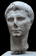 Marble head of the emperor Augustus (63BC-AD14) Roman.  Augustus was the first emperor and was very much the hub of the new political order.  People needed to see his image and in a society without mass media, the use of sculpture as propaganda was very important.
