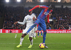 Crystal Palace's Cheikhou Kouyate (right) and Cardiff City's Junior Hoilett battle for the ball, during the Premier League match at Selhurst Park, south east London.