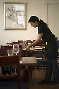 A  waitress sets the table at the <br /> Carmello Bistro, Tel Aviv, Israel