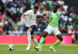 England's Gary Cahill (left) and Nigeria's Odion Ighalo battle for the ball during the International Friendly match at Wembley Stadium, London.