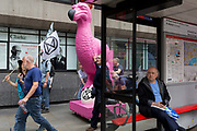 A pink Dodo is pushed through London streets en-route to where other environmental and climate change protesters block Fleet Street on the first day of a week-long country-wide protests using using five boats to stop traffic in Cardiff, Glasgow, Bristol, Leeds, and London, on 15th July 2019, in London, England. The group is calling on the government to declare a climate emergency, saying it was beginning a five-day summer uprising and that Ecocide ought to be a criminal offence in law.