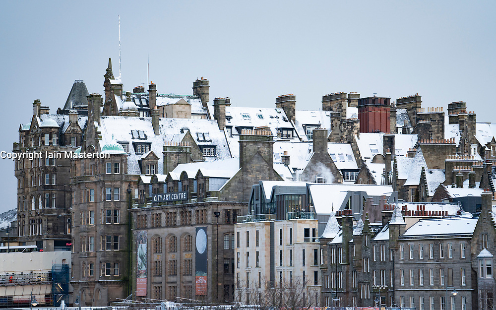 Edinburgh, Scotland, UK. 9 Feb 2021. Big freeze continues in the UK with Storm Darcy bringing several inches of snow to Edinburgh overnight. Pic; Snow covered rooftops in the Old Town. Iain Masterton/Alamy Live news