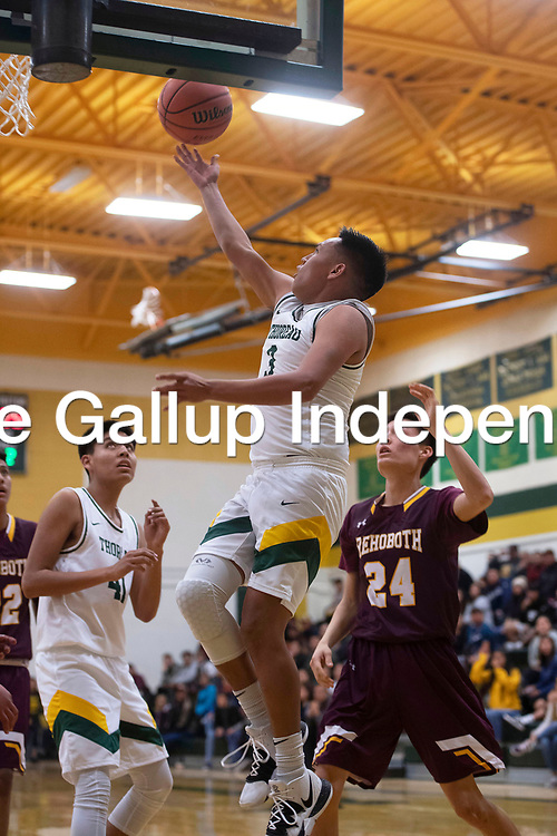 Thoreau Hawk Cordell Platero drives to the basket for a layup against Rehoboth Tuesday night in Thoreau.