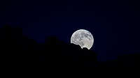 Moon rising in Arches National Park. Image taken with a Nikon D300 camera and 80-400 mm VR lens (ISO 400, 400 mm, f/11, 1/25 sec).