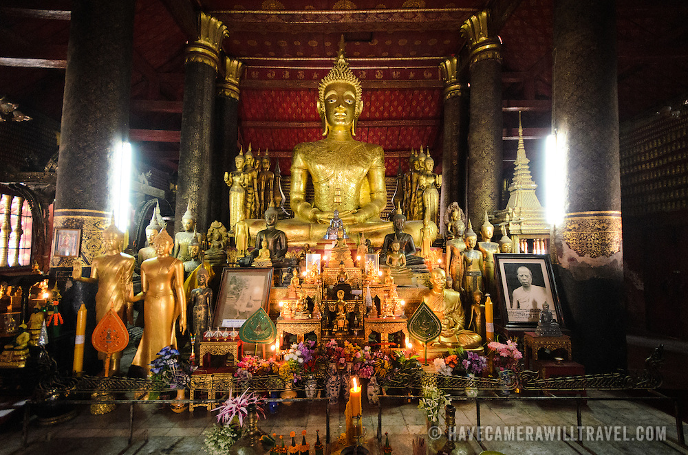 The main altar or shrine at Wat Mai Suwannaphumaham.  Wat Mai, as it is often known, is a Buddhist temple in Luang Prabang, Laos, located near the Royal Palace Museum. It was built in the 18th century and is one of the most richly decorated Wats in Luang Prabang.