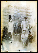 eroding glass plate photo of family