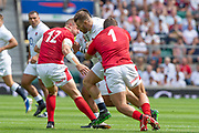 Twickenham, Surrey, World Cup, Sunday, Sunday, 11/08/2019  2019 World Cup, Warm up match, Quilter International, England vs Wales, at the RFU Stadium  [© Peter SPURRIER/Intersport Image]<br /> <br /> 14:02:38, Ellis Genge of England ' go's for the gap between  Left, Hadleigh Parkes of Wales and Nicky Smith of Wales