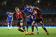Diego Costa of Chelsea pulls down Matt Ritchie of Bournemouth by his neck .Barclays Premier league match, Chelsea v AFC Bournemouth at Stamford Bridge in London on Saturday 5th December 2015.<br /> pic by John Patrick Fletcher, Andrew Orchard sports photography.