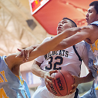 022114      Cable Hoover<br /> <br /> Chinle Wildcat Sooner Brady (32) slams through a block attempt by Alchesay Falcons Cody Clendon (34) and Arnold Walker (34) Friday at Monument Valley High School.