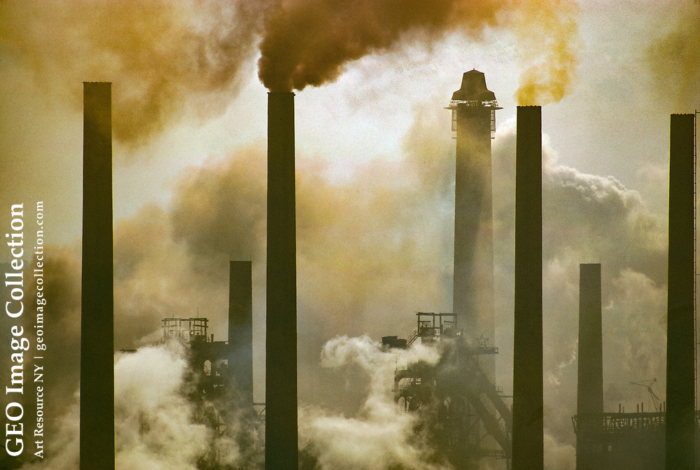 Smokestacks belching fumes at a steelworks plant.