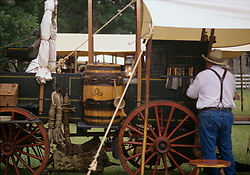 Man working to unload the wagon