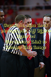 "31 January 2009: Coach Tim Jankovich gets an explanation from referee David Hall. The Illinois State University Redbirds join the Bradley Braves in a tie for 2nd place in ""The Valley"" with a 69-65 win on Doug Collins Court inside Redbird Arena on the campus of Illinois State University in Normal Illinois"