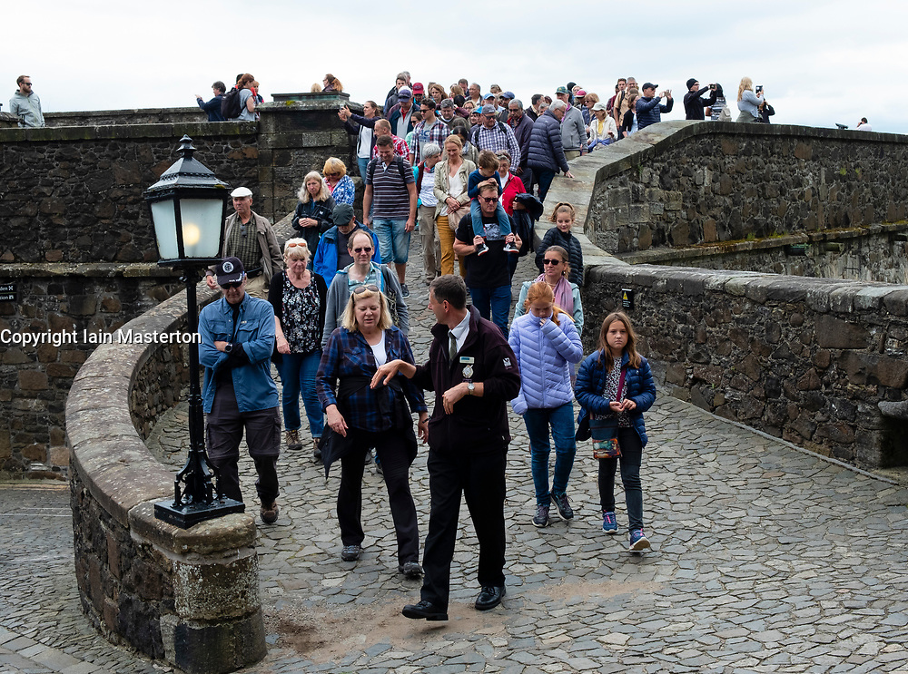 Tourists in a tour group inside Stirling Castle in Scotland, UK