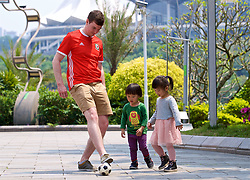 NANNING, CHINA - Thursday, March 22, 2018: Wales supporters play football with local children in Nanning ahead of the 2018 Gree China Cup International Football Championship match between China and Wales. (Pic by David Rawcliffe/Propaganda)