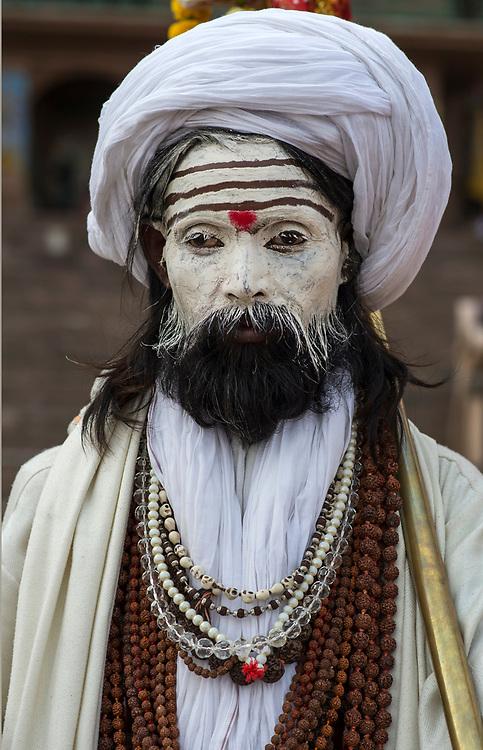 Sadhu pilgrim by the Ganges at Varanasi