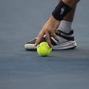 A ball boy collects the ball competition at the US Open. Flushing, New York, USA. 31st August 2013. Photo Tim Clayton
