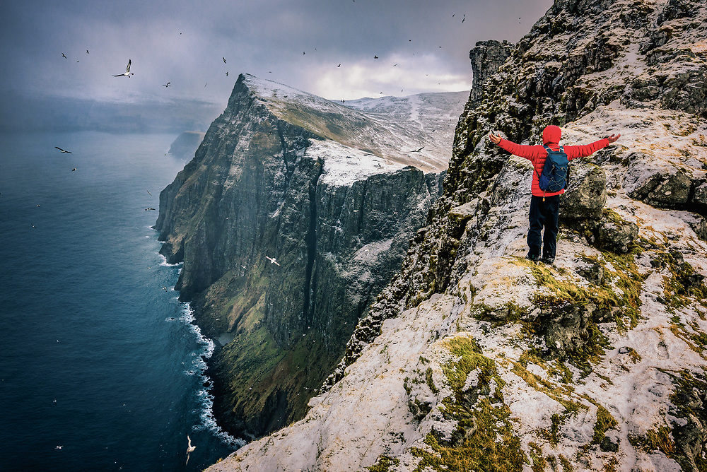 Flying with seagulls at Ritun¯va headland of V·gar. Seem like no metter in what direction you are going to go at Faroe Islands, you will find yourself upon the stunning view.