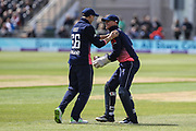 Joe Root of England congratulates Sam Billings of England after he caught the edge on Andrew Balbirnie of Ireland during the One Day International match between England and Ireland at the Brightside County Ground, Bristol, United Kingdom on 5 May 2017. Photo by Andrew Lewis.