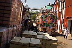 "Workers unload molasses used in several of the alcoholic beverages offered by Murree Brewery, Rawalpindi, Pakistan, Sept. 12, 2007. With a limited market in Islamic Pakistan, the company is looking for opportunities abroad. Soon the brewery's beer will be sold in Britain and India with the advertising slogan: ""Have a Murree with your curry."" The almost 150 year old company is preparing to bring the Muslim world's first 20 year old single malt whisky to the market. However, they can only sell to non-Muslims, who comprise 3 percent of Pakistan's population."