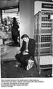 Man slumped asleep in late-night grocery shop  doorway. Shaftesbury Ave, Soho. London.5 December 1997<br />Film 97694f15<br />© Copyright Photograph by Dafydd Jones<br />66 Stockwell Park Rd. London SW9 0DA<br />Tel 0171 733 0108