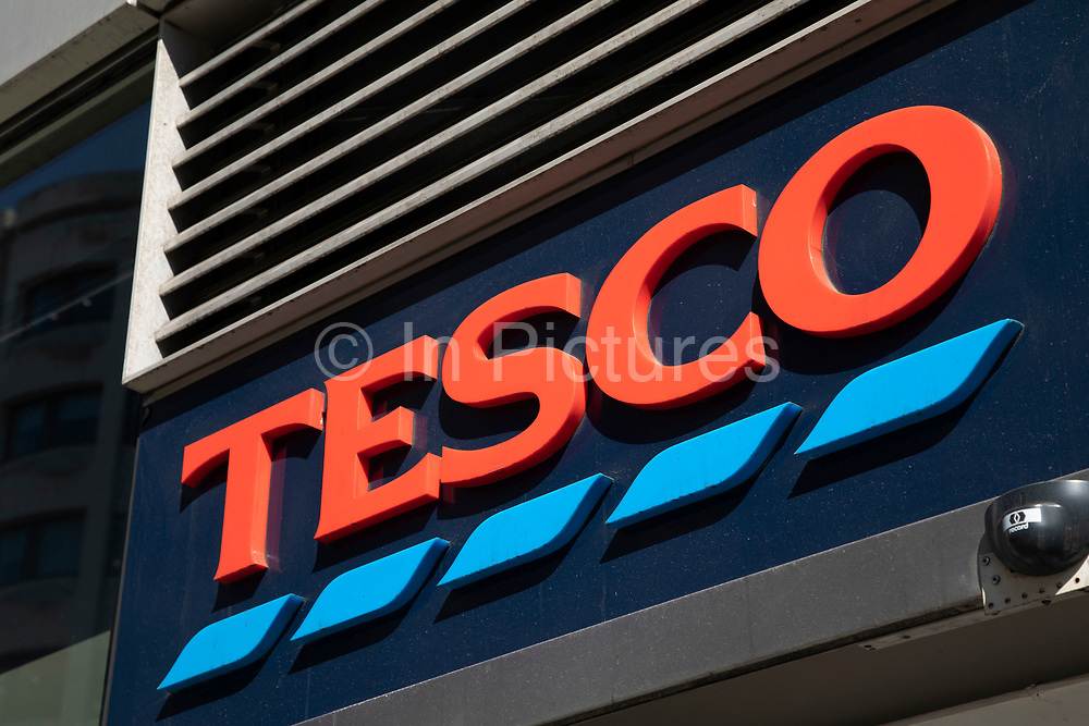 Tesco Express supermarket store logo in London, England, United Kingdom. Tesco plc is a global grocery and general merchandise retailer headquartered in the United Kingdom. It is the third-largest retailer in the world measured by revenues and the second-largest measured by profits. It has stores in 14 countries across Asia, Europe and North America and is the grocery market leader in the UK where it has a market share of around 30%. The company was founded by Jack Cohen in 1919 and opened its first store in 1929. It is a controversial success story in retail as it is often accused of strangling the market and pushing out smaller businesses and retailers.