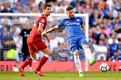 Liverpool's Dejan Lovren (left) and Chelsea's Olivier Giroud battle for the ball during the Premier League match at Stamford Bridge, London.
