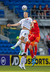 CARDIFF, WALES - Saturday, June 5, 2021: Albania\s Bekim Balaj (L) challenges for a header with Wales' Chris Mepham during an International Friendly between Wales and Albania at the Cardiff City Stadium in their game before the UEFA Euro 2020 tournament. (Pic by David Rawcliffe/Propaganda)