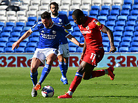 Football - 2020 / 2021 EFL Sky Bet Championship - Cardiff City vs Reading<br /> <br /> Greg Cunningham of Cardiff City on the attack Yakou Meite of Reading defends       , at the Cardiff City Stadium.