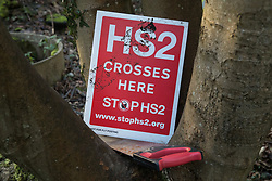 Wendover, UK. 10 January, 2020. A sign in the newly-established Wendover Active Resistance Camp. Stop HS2 activists from around the UK established the camp in woodland outside Wendover on the proposed route for HS2 through the Chilterns AONB in response to requests for assistance from members of the local community opposed to the high speed rail link. The impact on the immediate area is expected to be even worse than initially expected, with not only two 500m viaducts and a 1km embankment to be constructed but also a Bentonite factory and 240-bed accommodation block.