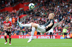 """Burnley's Ben Mee attempts an overhead kick during the Premier League match at St Mary's, Southampton. PRESS ASSOCIATION Photo. Picture date: Sunday August 12, 2018. See PA story SOCCER Southampton. Photo credit should read: Andrew Matthews/PA Wire. RESTRICTIONS: EDITORIAL USE ONLY No use with unauthorised audio, video, data, fixture lists, club/league logos or """"live"""" services. Online in-match use limited to 120 images, no video emulation. No use in betting, games or single club/league/player publications."""