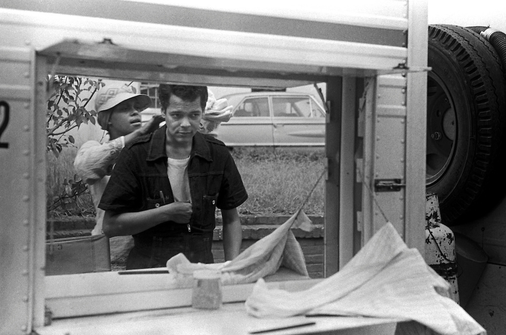 """Civil rights leader, politician, actor and former Chairman of the NAACP, Julian Bond, has died at age 75. Bond is reflected in a movie set  makeup trailer mirror during the filming of the 1977 feature film, """"Greased Lightning"""".  The film starred Grier, Richard Pryor and Beau Bridges and chronicled the life of the first African American NASCAR driver - Wendell Scott."""