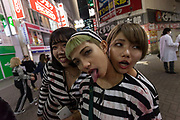 Japanese women dressed as prisoners during the Halloween celebrations Shibuya, Tokyo, Japan. Saturday October 27th 2018. The celebrations marking this event have grown in popularity in Japan recently. Enjoyed mostly by young adults who like to dress up, drink , dance and misbehave in parts of Tokyo like Shibuya and Roppongi. There has been a push back from Japanese society and the police to try to limit the bad behaviour.