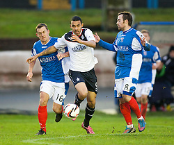 Cowdenbeath's Aaron Lynas and Falkirk's Phil Roberts.<br /> half time : Cowdenbeath 0 v 0 Falkirk, Scottish Championship game today at Central Park, the home ground of Cowdenbeath Football Club.<br /> © Michael Schofield.
