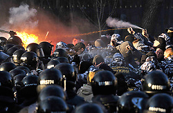 March 27, 2019 - Vinnytsia, Ukraine - National Militia members spray tear gas at police officers whose lines caught fire during a standoff with protesters, Vinnytsia, central Ukraine, March 27, 2019. As reported, activists of the National Corps and the National Militia marched to Vasylia Stusa Square where a meeting of presidential candidate and incumbent President Petro Poroshenko with voters was due to take place. Three demonstrators were detained. Ukrinform. (Credit Image: © Lapin Oleksandr/Ukrinform via ZUMA Wire)
