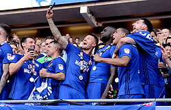 Cardiff City players take a selfie to celebrate winning their promotion to the Premier League after the Sky Bet Championship match at the Cardiff City Stadium.