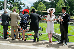 © Licensed to London News Pictures. 18/06/2014. Ascot, UK Day two at Royal Ascot 18th June 2014. Royal Ascot has established itself as a national institution and the centrepiece of the British social calendar as well as being a stage for the best racehorses in the world. Photo credit : Stephen Simpson/LNP