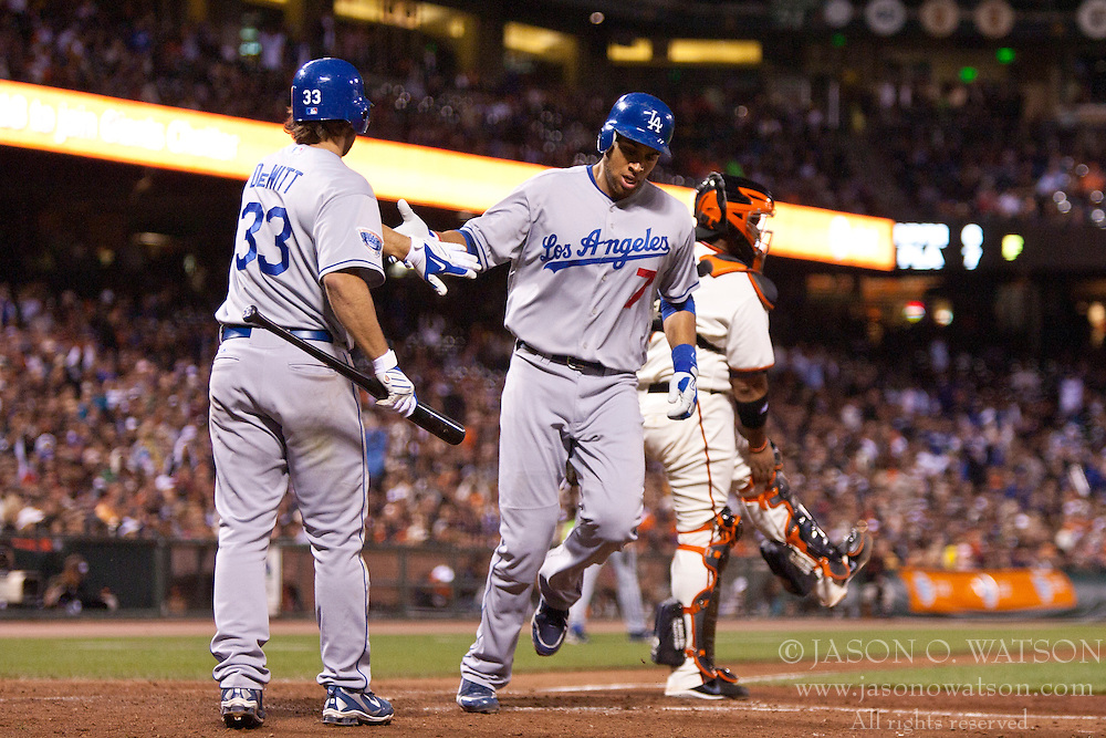 June 29, 2010; San Francisco, CA, USA;  Los Angeles Dodgers first baseman James Loney (7) is congratulated at home plate by second baseman Blake DeWitt (33) after scoring a run against the San Francisco Giants during the fifth inning at AT&T Park.