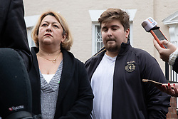 """© Licensed to London News Pictures. 16/11/2019. Bolton, UK. SANDRA RUIZ and TIAGO ALVES of Grenfell United, both of whom are former Grenfell Tower residents , at a press conference at the site of the blaze . Firefighters work at the scene where a fire broke out overnight (15th/16th November 2019) at a block of flats known as """" The Cube """" , in Bolton Town Centre . At least two people are known to have been treated by paramedics at the scene of the six-story block , which is occupied by students of the University of Bolton . Photo credit: Joel Goodman/LNP"""