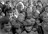 Jimmy Savile with young fans at a Pop for Peace Concert at Crawfordsburn Country Park, Co Down, N Ireland, November 1976. 197611130449a<br /> <br /> Copyright Image from Victor Patterson, 54 Dorchester Park, Belfast, UK, BT9 6RJ<br /> <br /> t1: +44 28 9066 1296 (from Rep of Ireland 048 9066 1296)<br /> t2: +44 28 9002 2446 (from Rep of Ireland 048 9002 2446)<br /> m: +44 7802 353836<br /> <br /> victorpattersonbelfast@gmail.com<br /> victorpatterson@me.com<br /> <br /> www.victorpatterson.com<br /> <br /> Please see my Terms and Conditions of Use at https://www.victorpatterson.com/page2<br /> It is IMPORTANT that you familiarise yourself with them.<br /> <br /> Images used on the Internet incur an additional cost and must be visibly watermarked i.e. © Victor Patterson within the body of the image and copyright metadata must not be deleted. Images used on the Internet have a size restriction of 4kbs and are chargeable at rates available at victorpatterson.com.<br /> <br /> This image is available only for the use of the download recipient i.e. television station, newspaper, magazine, book publisher, etc, and must not be passed on to any third party. It is also downloaded on condition that each and every usage is notified within 7 days to victorpatterson@me.com<br /> <br /> The right of Victor Patterson (or the named photographer) to be identified as the author is asserted in accordance with The Copyright Designs And Patents Act (1988). All moral rights are asserted.