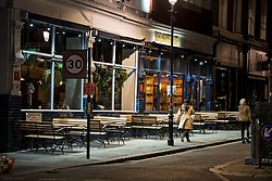 © Licensed to London News Pictures. 25/09/2020. London, UK. Empty seats a bar on Portobello Road, Notting Hill, west London before before a 10pm curfew comes in to place as part of new restrictions intended to prevent the spread of COVID-19. Photo credit: Ben Cawthra/LNP