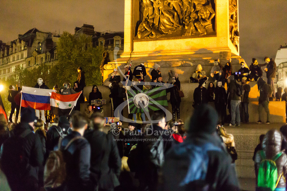 London, November 05 2017. Anti-capitalists gather in Trafalgar Square, London for the annual 'Million Mask March' which happens on November 5th every year, with many of the protesters donning 'V' For Vendetta Guy Fawkes masks. Past marches have turned violent with police horses shot by fireworks and police vehicles burned. PICTURED: Protesters gather at the base of Nelson's column. © Paul Davey