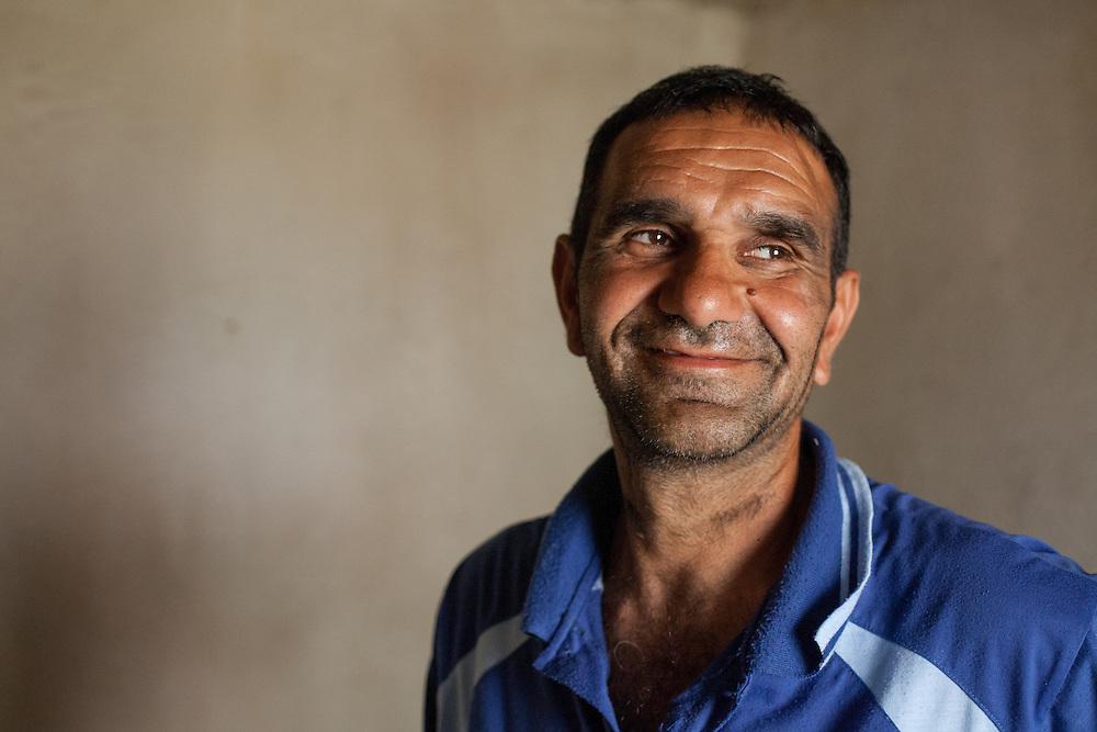 Portrait of a man in his house living in the Roma part of the city of Crnik, Macedonia. (He did not like to make his name public).