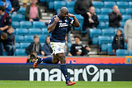 Danny Shittu of Millwall celebrates after scoring his teams first goal of the game making it 1-0. Skybet football league championship match , Millwall v Cardiff city at the Den in Millwall, London on Saturday 25th October 2014.<br /> pic by John Patrick Fletcher, Andrew Orchard sports photography.
