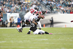 Atlanta Falcons running back Michael Turner (33) is tackled by Philadelphia Eagles strong safety Nate Allen (29) during the NFL game between the Atlanta Falcons and the Philadelphia Eagles on Sunday, October 28th 2012 in Philadelphia. The Falcons won 30-17. (Photo by Brian Garfinkel)