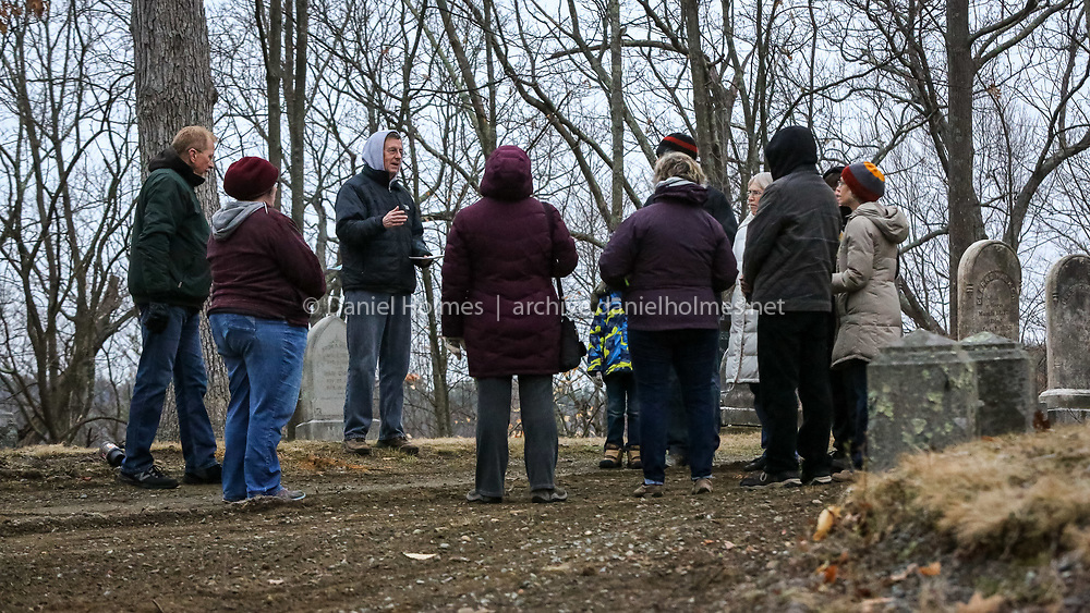 (3/27/16, MEDWAY, MA) Pastor Jim Longhurst, third from left, of the Medway Village Church, leads a sunrise Easter service at Oakland cemetery in Medway on Sunday. Daily News and Wicked Local Photo/Dan Holmes