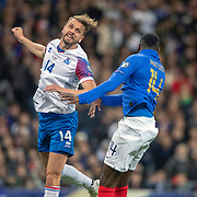 PARIS, FRANCE - March 25:  Kari Arnason #14 of Iceland and Blaise Matuidi #14 of France challenge for the ball during the France V Iceland, 2020 European Championship Qualifying, Group Stage at  Stade de France on March 25th 2019 in Paris, France (Photo by Tim Clayton/Corbis via Getty Images)