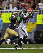Seattle wide receiver Deion Branch (83) catches a fourth quarter touchdown pass over St. Louis defensive back Travis Fisher (22) at the Edward Jones Dome in St. Louis, Missouri, October 15, 2006.  The Seahawks beat the Rams 30-27.<br />
