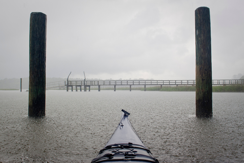 Kayak bow and rain falling on the May River west of Bluffton, SC.